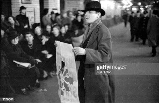 Busker Frank Bates makes his living by tearing patterns out of paper for the crowds in London's West End Original Publication Picture Post 52 Buskers...