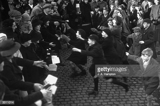 Happy evacuee children rush to greet their parents off the special London Midland and Scottish train in Northampton