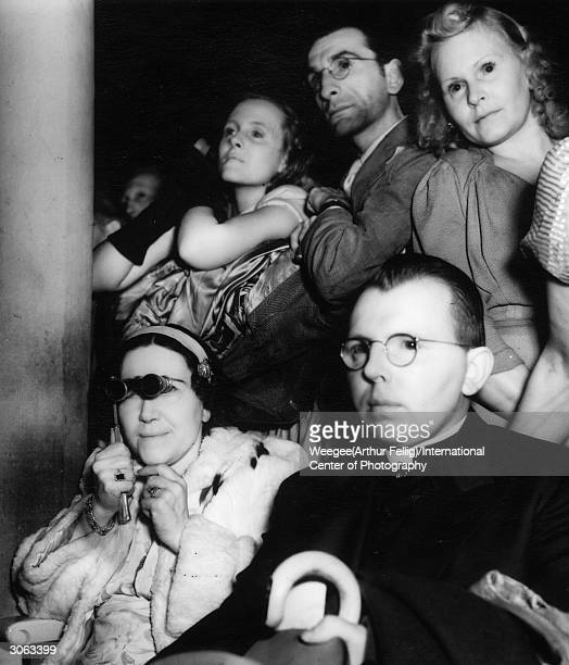 The audience at the opening night of 'Faust' at the Met New York's Metropolitan Opera Using infrared negative Photo by Weegee/International Center of...