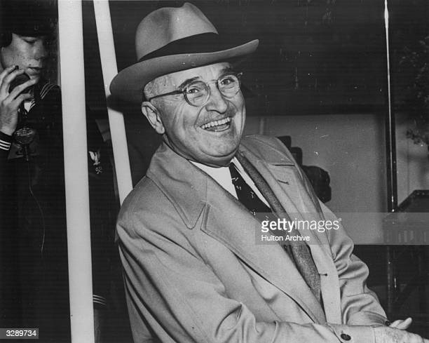 American statesman Harry S Truman the 33rd President of the United States of America laughing on board the 'Williamsburg' bound for Florida on...