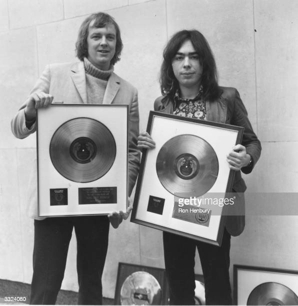 Lyricist Tim Rice and composer, Andrew Lloyd-Webber holding their gold and platinum records for their album 'Jesus Christ Superstar'.