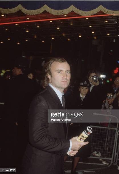 Phil Collins drummer and singer with British rock band Genesis arrives at the premiere of 'Back to the Future'