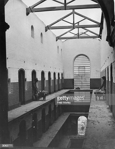 Demolition workers remove bricks from demolished cells in Warwick Prison before constructing a garden village in its place with an estate of 120...