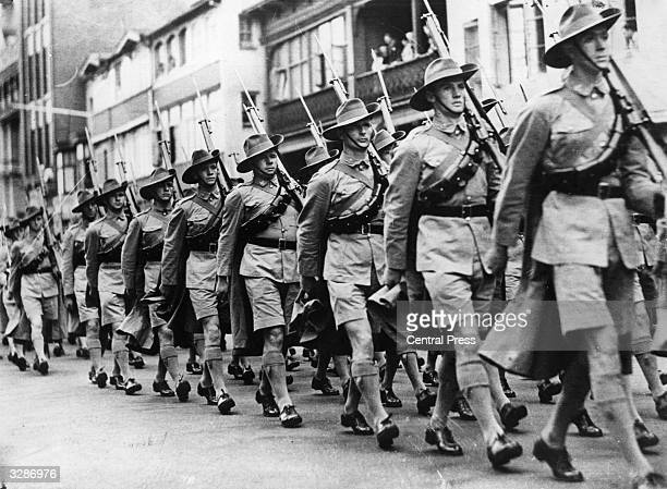 Watching from a balcony Sir Anthony Eden Dominions Secretary inspects Australian troops after their arrival in the Middle East
