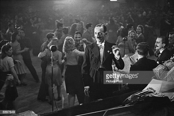 Lou Praeger and his band perform at the Hammersmith Palais de Danse, to a crowd of dancing London youth. Original Publication: Picture Post - 1895 -...
