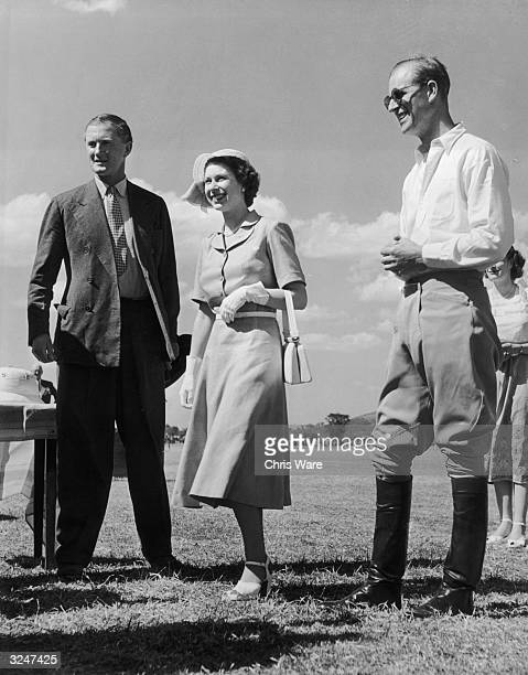 Princess Elizabeth and the Duke of Edinburgh attend a polo match at Nyeri in Kenya only days before the death of her father King George VI