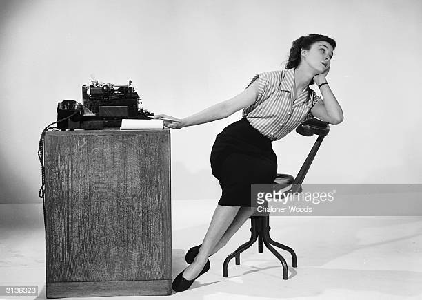 A model posing with a selection of office equipment
