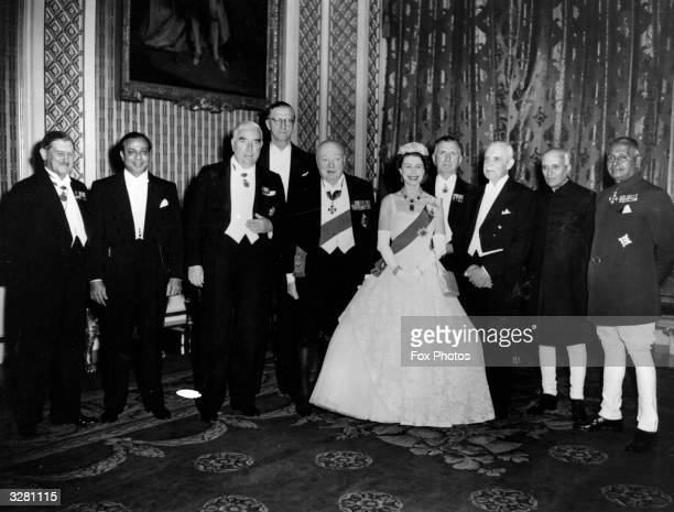 Queen Elizabeth II as head of the Commonwealth with the Commonwealth Prime Ministers at Buckingham Palace London at the time of the Commonwealth...