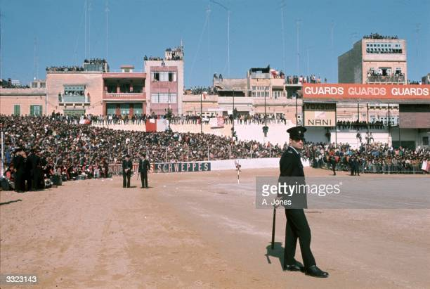 Police keeping an eye on the crowd at the European Championship qualifying match between Malta and England at Valletta in Malta