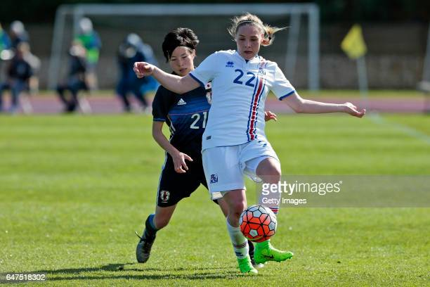 Hikaru Kitagawa of Japan Women challenges Rakel Honnudottir of Iceland Women during the match between Japan v Iceland Women's Algarve Cup on March...