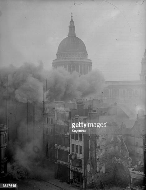 Several London buildings which were unsafe after a bombing raid on London during the blitz are blown up by the Royal Engineers