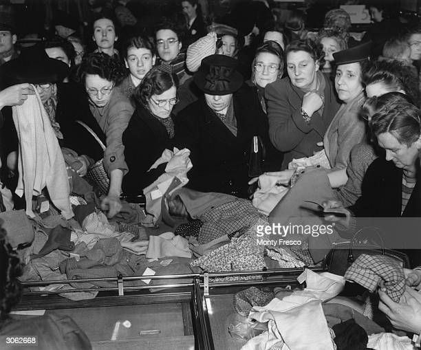 Shoppers compete for dresses at the bargain price of five shillings each at the CA January sale in Oxford Street London
