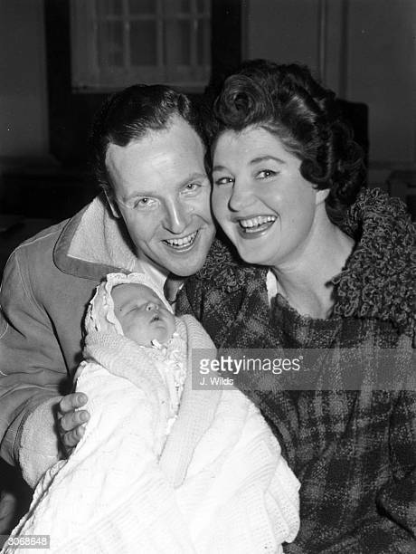 British light entertainer Nicholas Parsons and his wife Denise Bryer with their baby son Hugh Justin