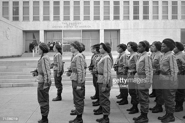 Castro militia girls march to the American Embassy in Havana to take up guard positions as Washington severs relations and diplomats evacuate the...