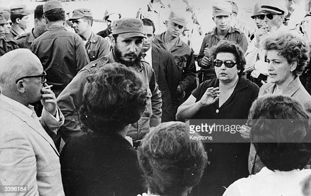 Cuban prime minister Fidel Castro talking with parents of some of the American prisoners held hostage for food and supplies by the Cuban government...