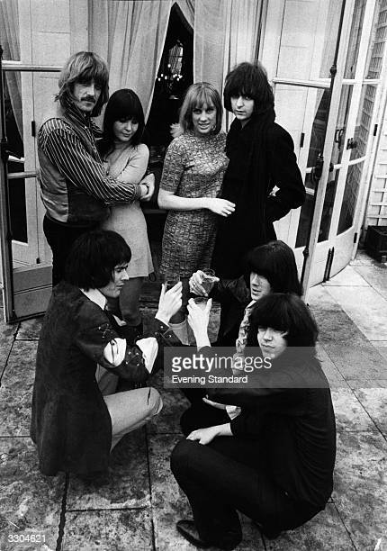 British rock group Deep Purple celebrate as two members of the group keyboard player Jon Lord left and guitarist Ritchie Blackmore right get engaged...
