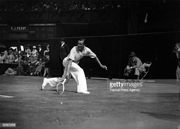 Fred Perry of Great Britain in action on the Centre Court against Jack Crawford of Australia during the semifinals of the All England Lawn Tennis...