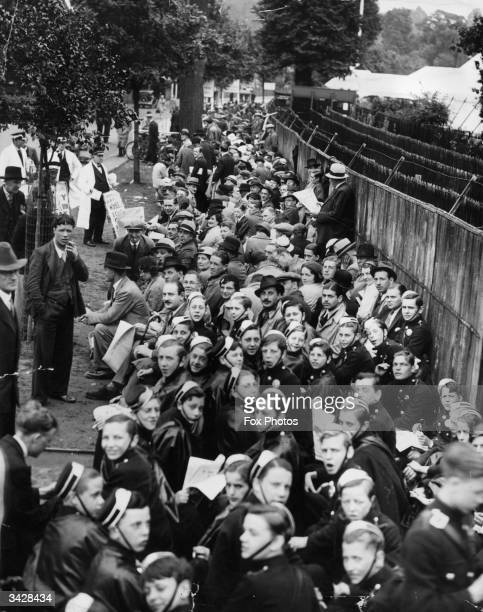 Crowds queuing outside the gates of Wimbledon in London to see the finals of the Men's Tennis Championships between Fred Perry and Gottfried Von...
