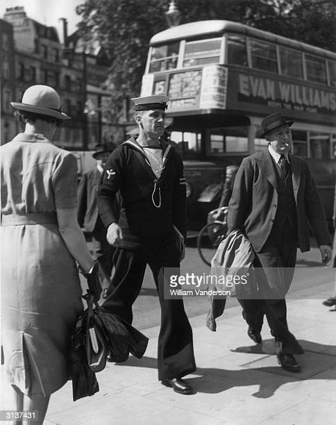One of the survivors of the Thetis disaster Stoker Arnold arrives at the Law Courts to attend an enquiry. The British submarine Thetis sank in...