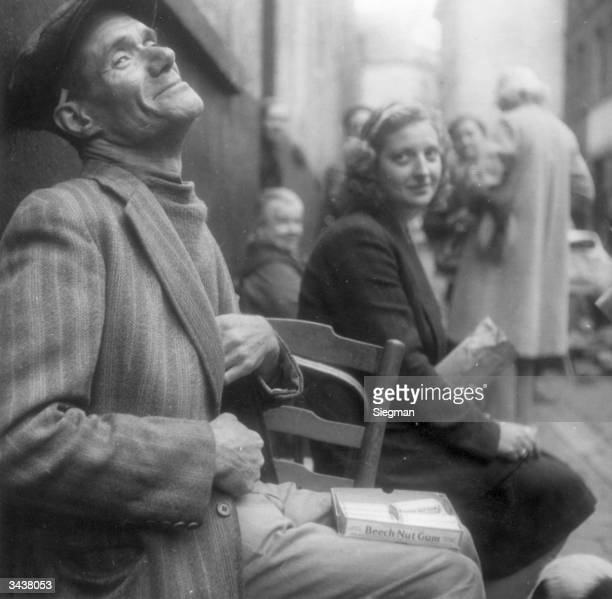 Rue de Radis in Brussels in the last few weeks of WW II Well known for its black market operators this man is selling chewing gum but has other...