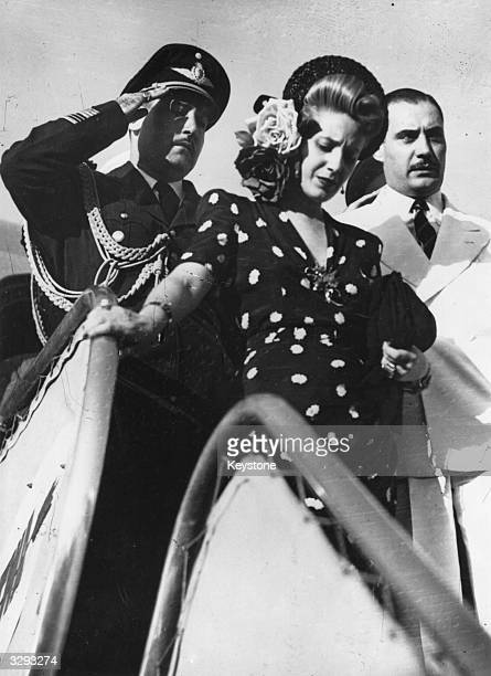Madame Eva Duarte De Peron , wife of the Argentine President, getting out of a plane in Rome on one of her many trips to that city.
