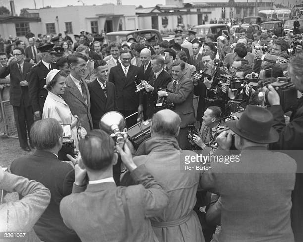 Explorer Edmund Hillary and the victorious Everest team arrive at London airport to receive a rapturous welcome