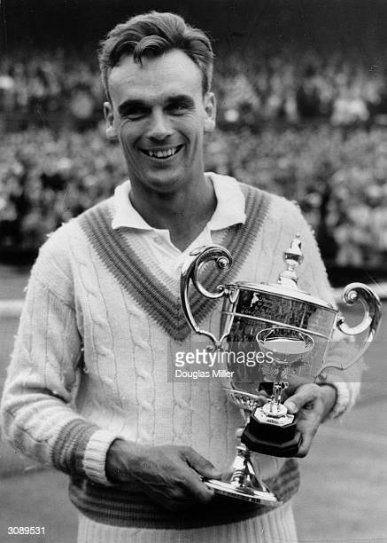 Vic Seixas of America with the cup for winning the Men's Singles at Wimbledon when he beat Kurt Neilson of Denmark