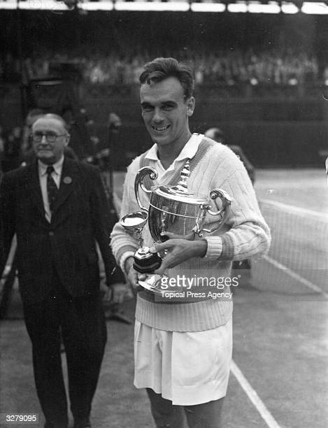 Vic Seixas with his Men's Singles trophy at Wimbledon after beating Kurt Nielsen in the final