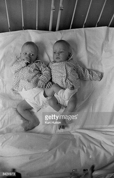 Folkje de Vries with her sister Tjitske Siamese twins who were successfully parted by doctors in Holland Original Publication Picture Post 7197 The...