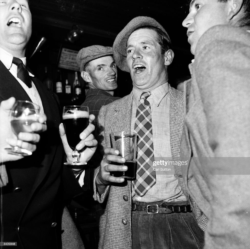 Locals at the 'Fox and Goose' in Parracombe, Devon, having a drink and a sing-song. Original Publication: Picture Post - 7202 - We Are Murdering Our Countryside - pub. 1954