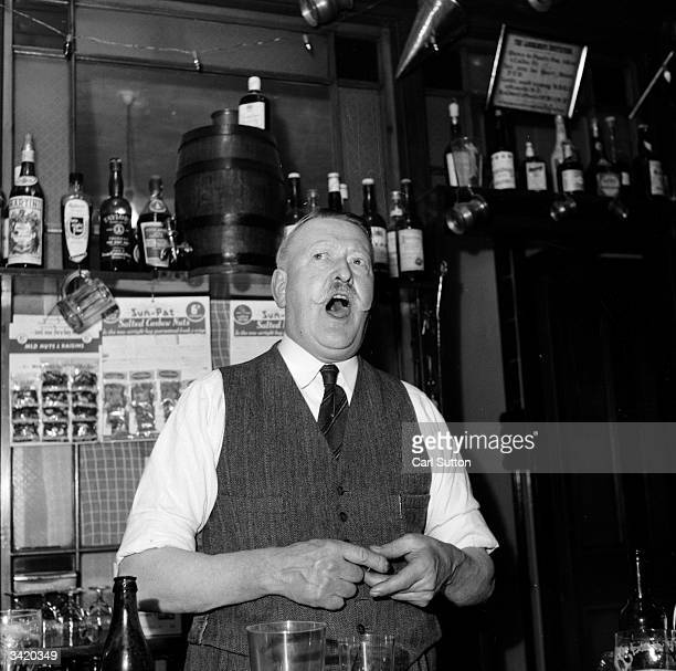 Village publican Bill Creek shouting for last orders at the 'Fox and Goose' in Parracombe Devon Original Publication Picture Post 7202 We Are...