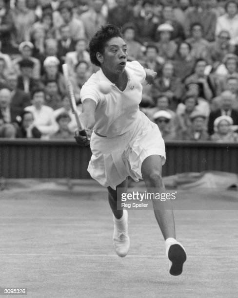 America's Althea Gibson in play against Shirley Fry on the centre court at Wimbledon London during the 1956 women's quarter finals