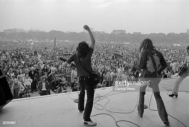 From left to right Peter Frampton and Steve Marriott of the group 'Humble Pie' at a free openair pop concert in Hyde Park London