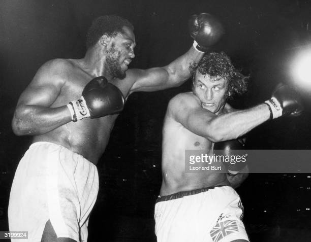 Joe Frazier and Joe Bugner during a world title eliminator fight at Earl's Court London Frazier emerged the winner after a very hardfought match