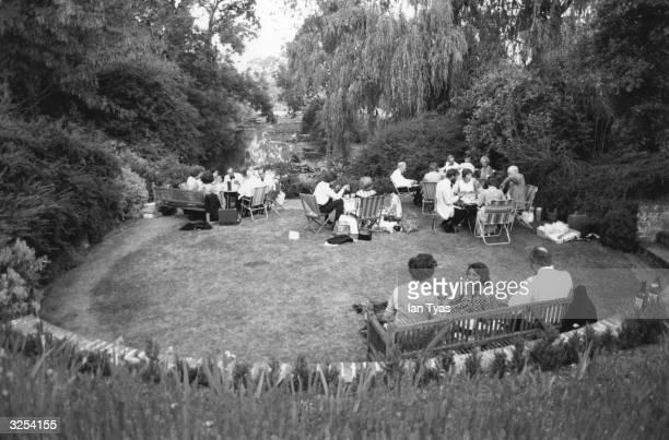 Operagoers enjoying picnics on the lawns of Glyndebourne Surrey
