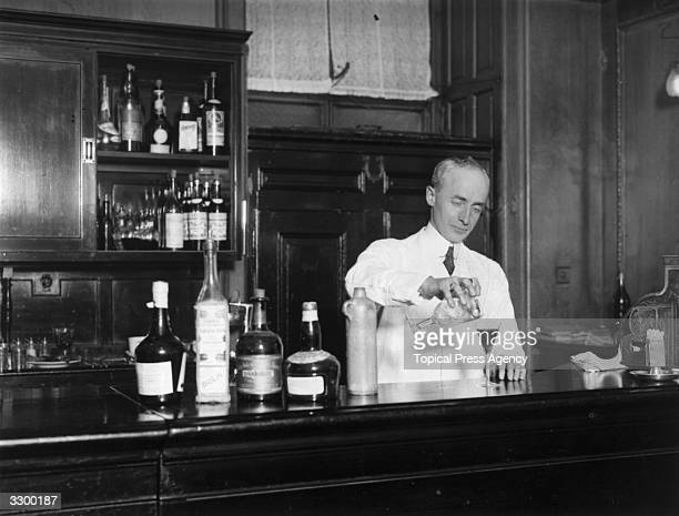 American barman Harry Craddock expertly mixes a drink in the American bar of the Savoy Hotel in London Author of 'The Savoy Cocktail Book' Craddock...