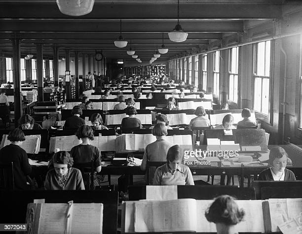 Hundreds of women at work at the Pensions Office in Acton, London, compiling information from the Census of April 1931.