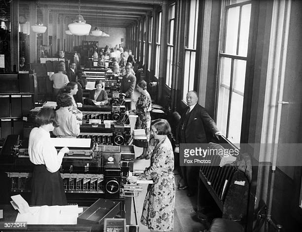 Women using handpunching Hollerith machines to process census cards at the Pensions Office in Acton London The cards contain information compiled at...