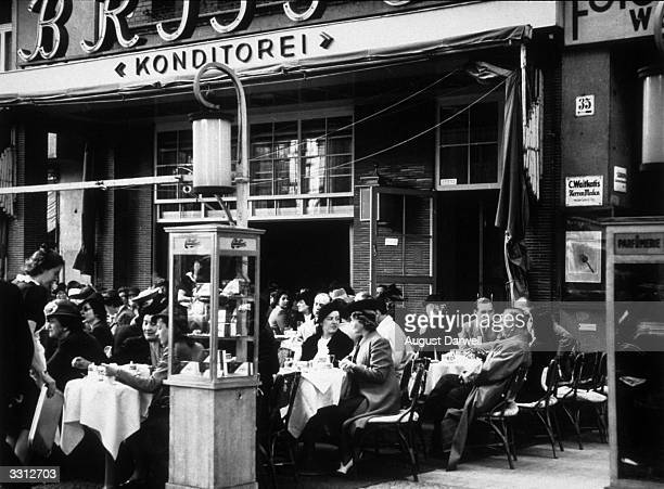 A general view of an openair cafe in Berlin Original Publication Picture Post 152 Berlin On A Sunny Day pub 1939