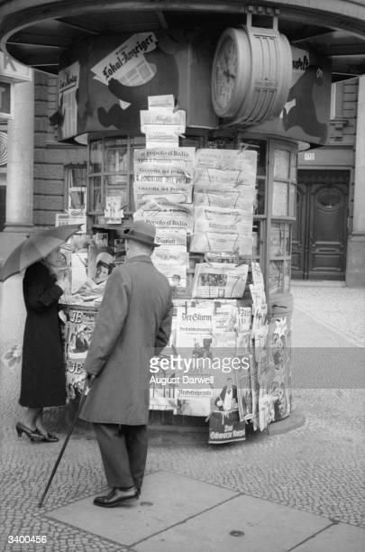 A German newspaper kiosk in a Berlin street Original Publication Picture Post 152 Berlin On A Sunny Day pub 1939