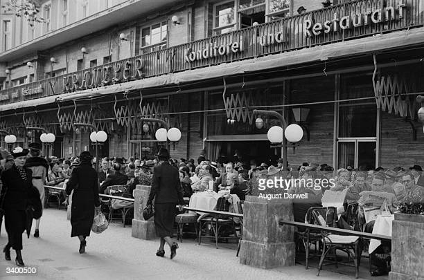 Enjoying the mild weather at an outdoor cafe in Berlin prior to the Second World War Original Publication Picture Post 152 Berlin On A Sunny Day...