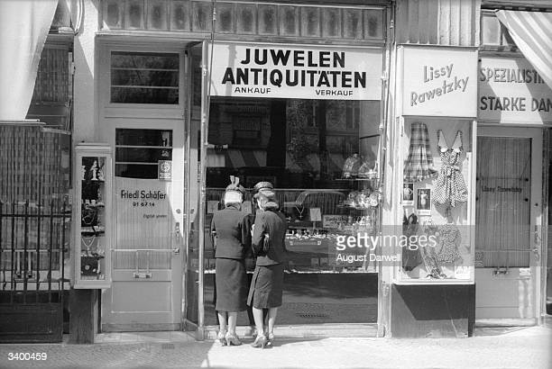 Two women looking in the window of an antique jewellery shop in Berlin Original Publication Picture Post 152 Berlin On A Sunny Day pub 1939