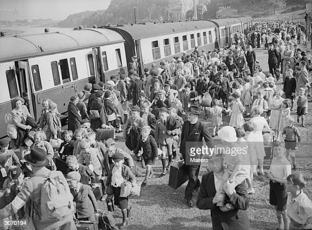 Evacuees arriving at a railway station in South Wales