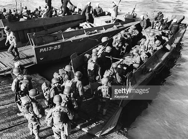 US troops board their Landing Craft VehiclePersonnel at Torquay Hards England prior to landing on the Normandy coast