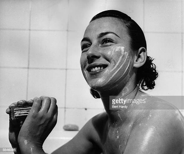 American tennis player Gertrude 'Gussie' Moran taking a refreshing bath in her hotel in Paris She follows the advice of her mother and soaps her face...