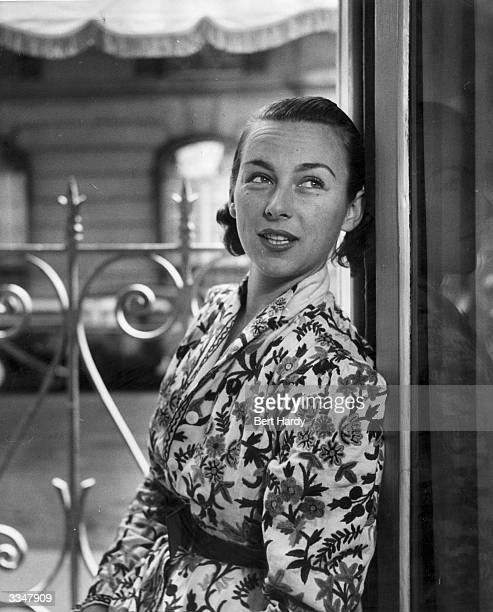 American tennis player Gertrude 'Gussie' Moran wearing a floral dressing gown at the hotel she is staying at in Paris Original Publication Picture...