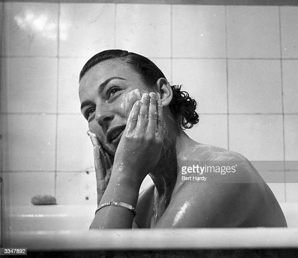 American tennis player Gertrude Moran or Gorgeous Gussie having a bath in her Paris hotel Original Publication Picture Post 5051 A Weekend With Gussy...