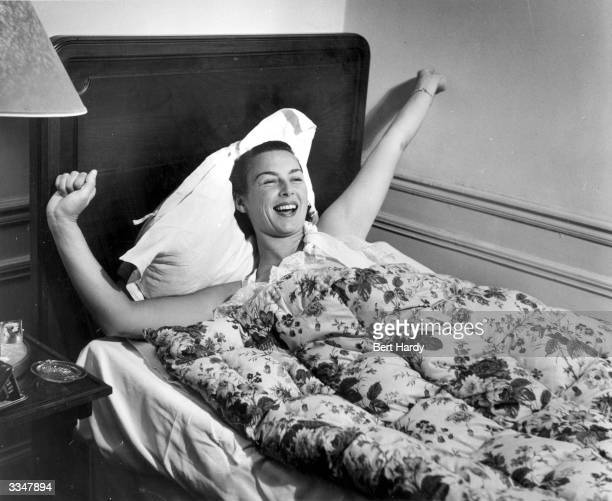 American tennis player Gertrude Moran or Gorgeous Gussie waking up in her Paris hotel room Original Publication Picture Post 5051 A Weekend With...