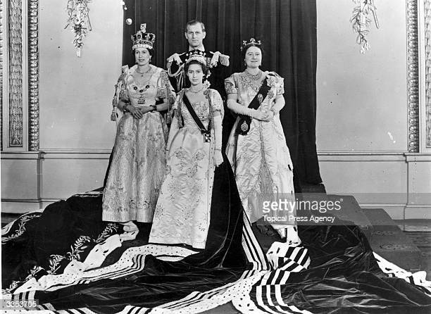 Queen Elizabeth II with Philip Duke of Edinburgh Princess Margaret Rose and Queen Elizabeth The Queen Mother wearing full Coronation regalia in the...