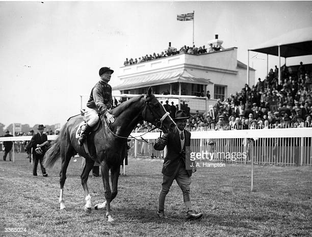 Jockey E Smith being led in on race horse Aureole after winning the Coronation Cup at Epsom